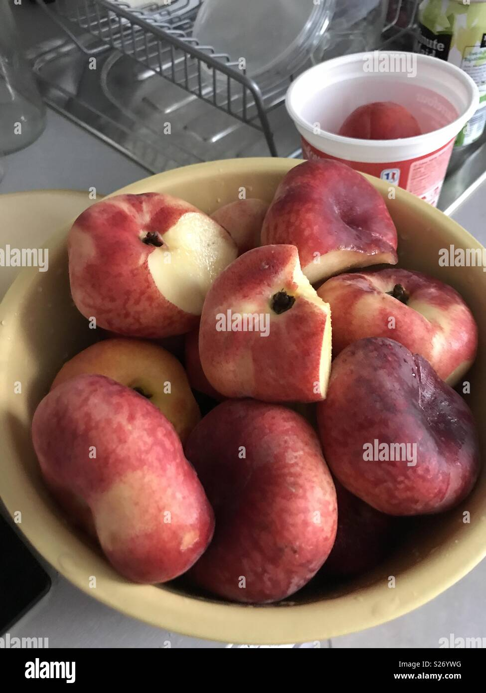 Paris, France. Partially spoiled peaches, cut and kept in a bowl - Stock Image