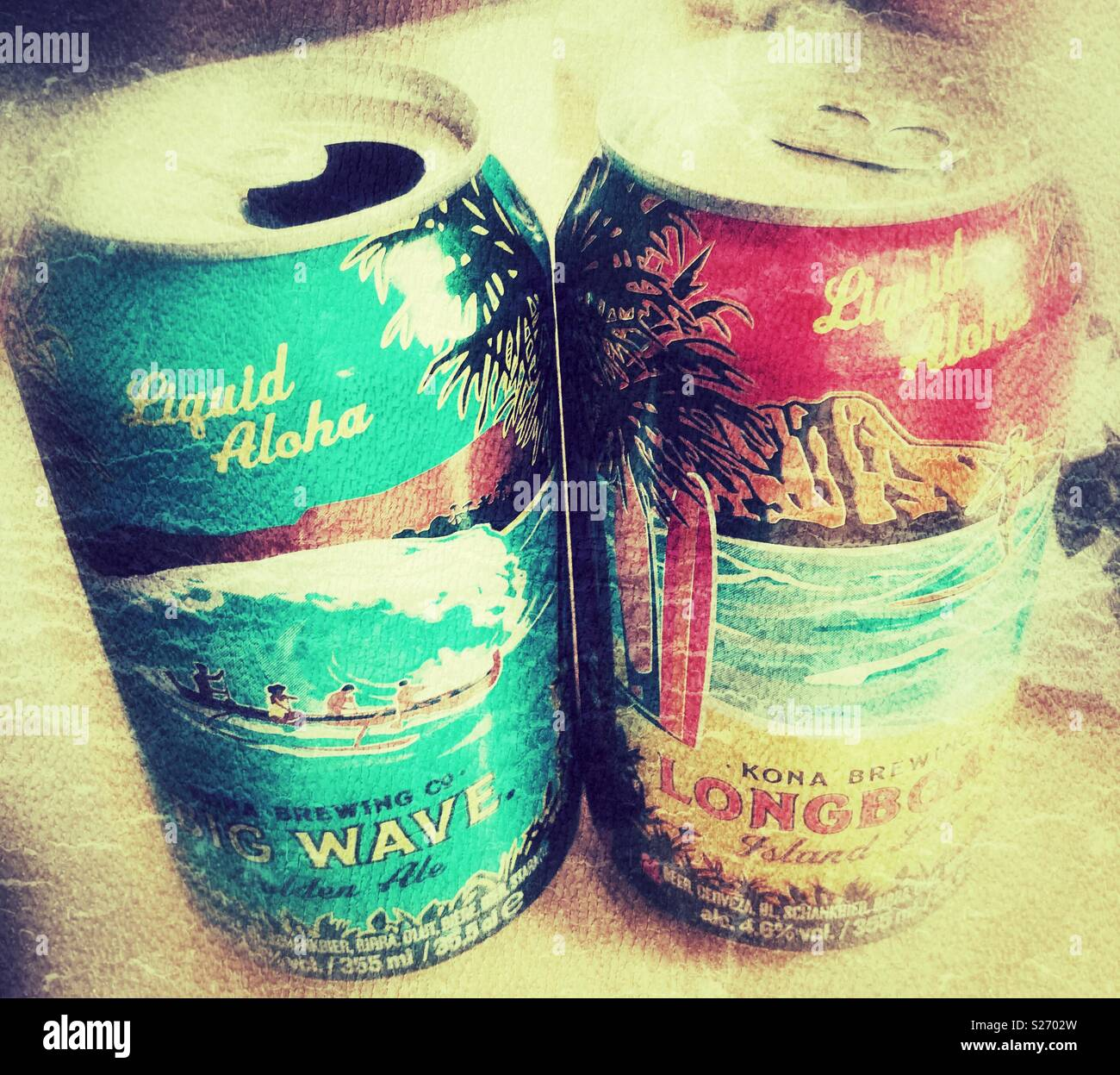 Two cans of Kona beer on a table - one open, one still closed. - Stock Image