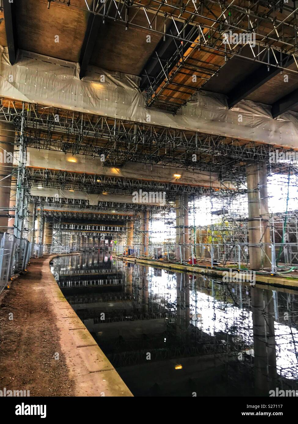 Scaffolding under Oldbury viaduct from the towpath. - Stock Image