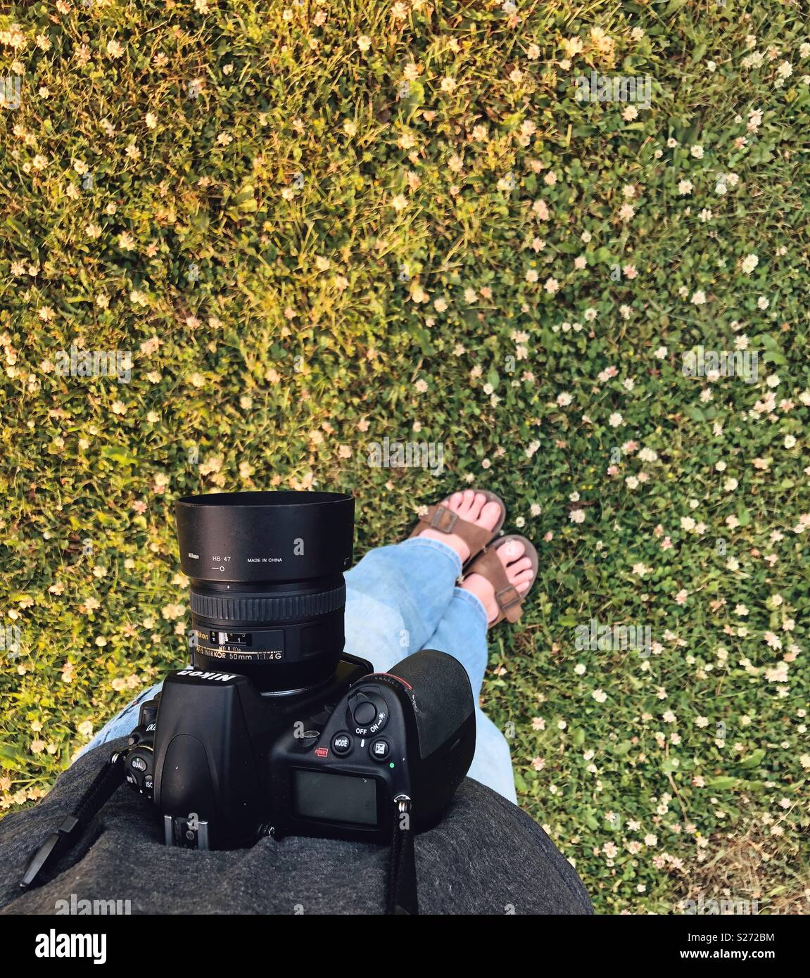 Point of view image of person standing in clover patch with Nikon