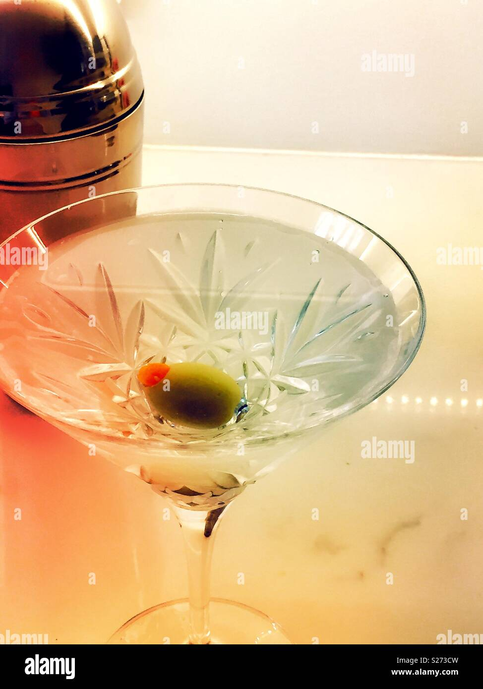 The classic dry gin martini with Spanish Olive  in Waterford crystal martini glass, USA - Stock Image