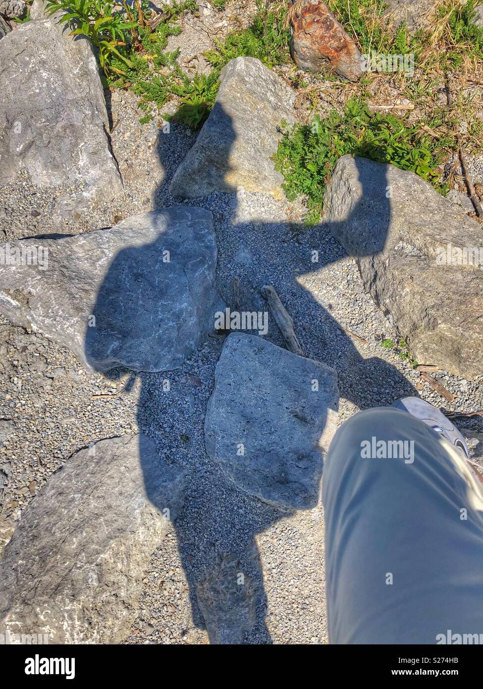Shadow climbing. - Stock Image