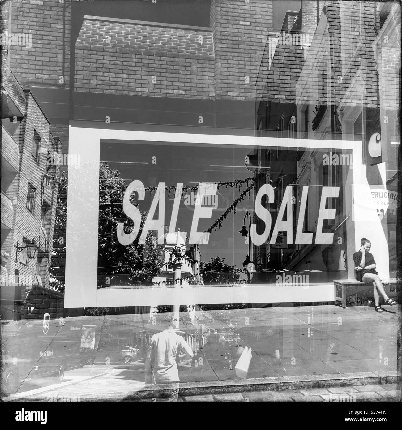 Double exposure, sale sign - Stock Image