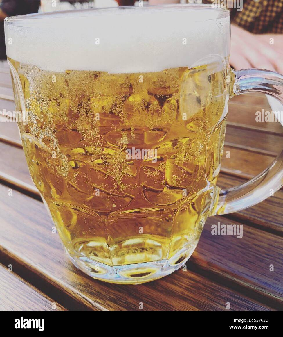 Full pint of beer in an old fashioned pint pot - Stock Image