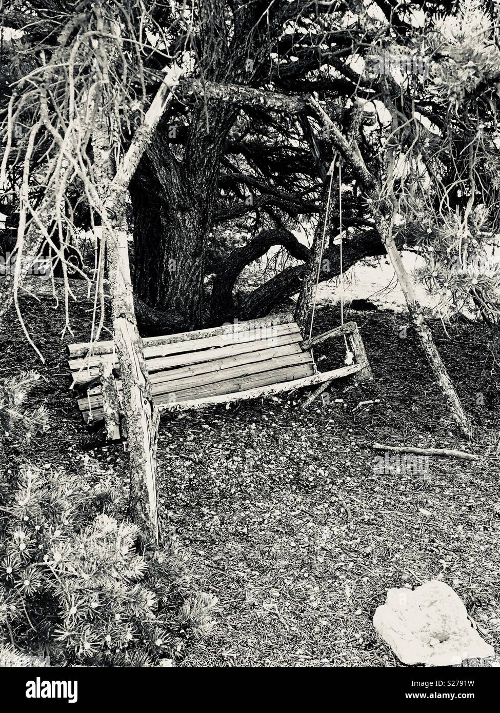 A rickety old wooden swing in Salida, Colorado - Stock Image