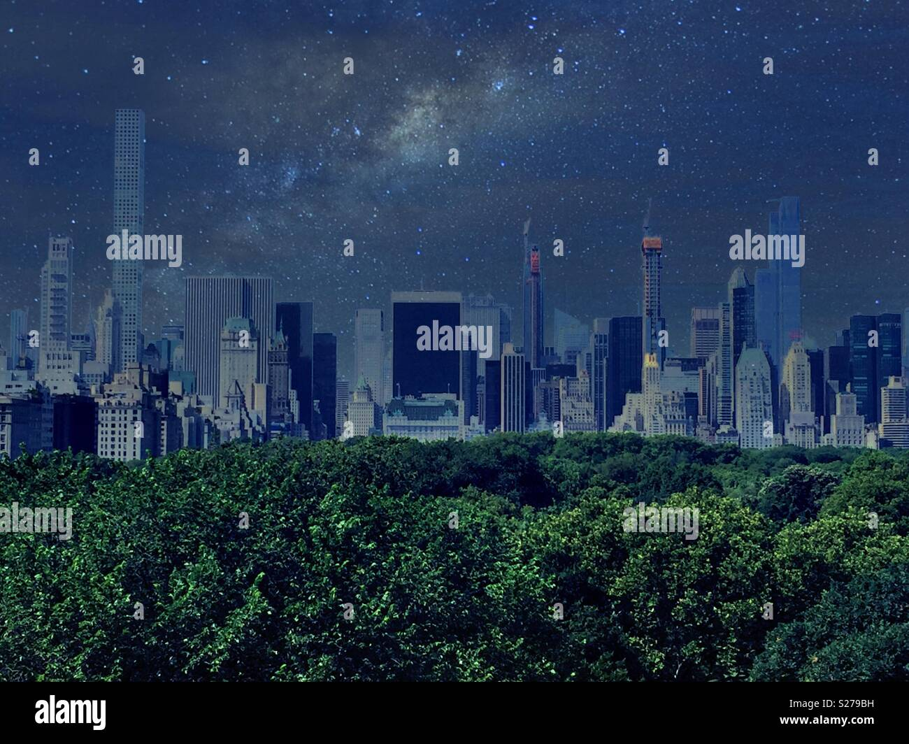 Night time image of midtown Manhattan skyline with Central Park trees in the foreground, NYC, USA - Stock Image
