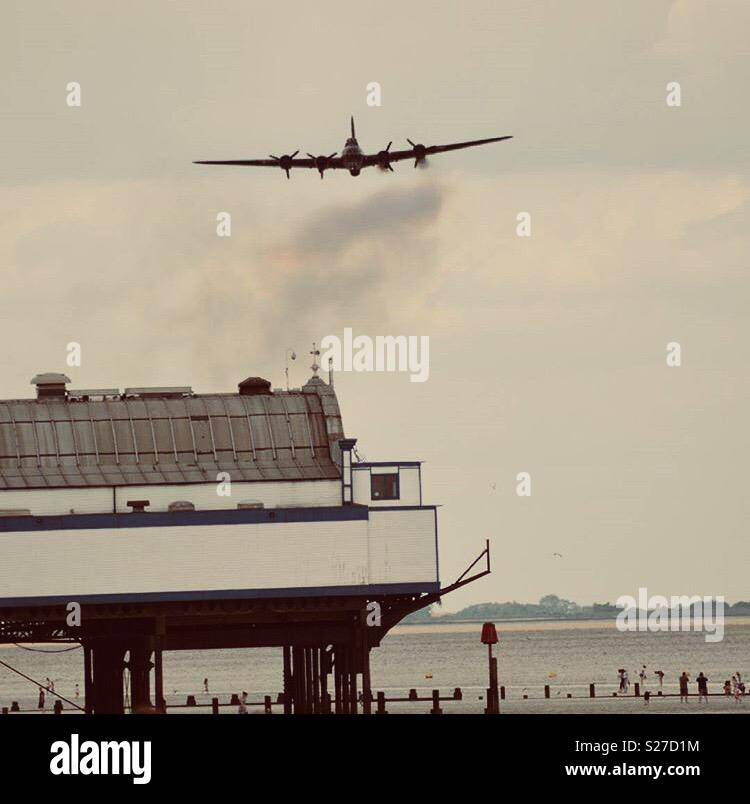 B17 Bomber flying over cleethorpes pier - Stock Image