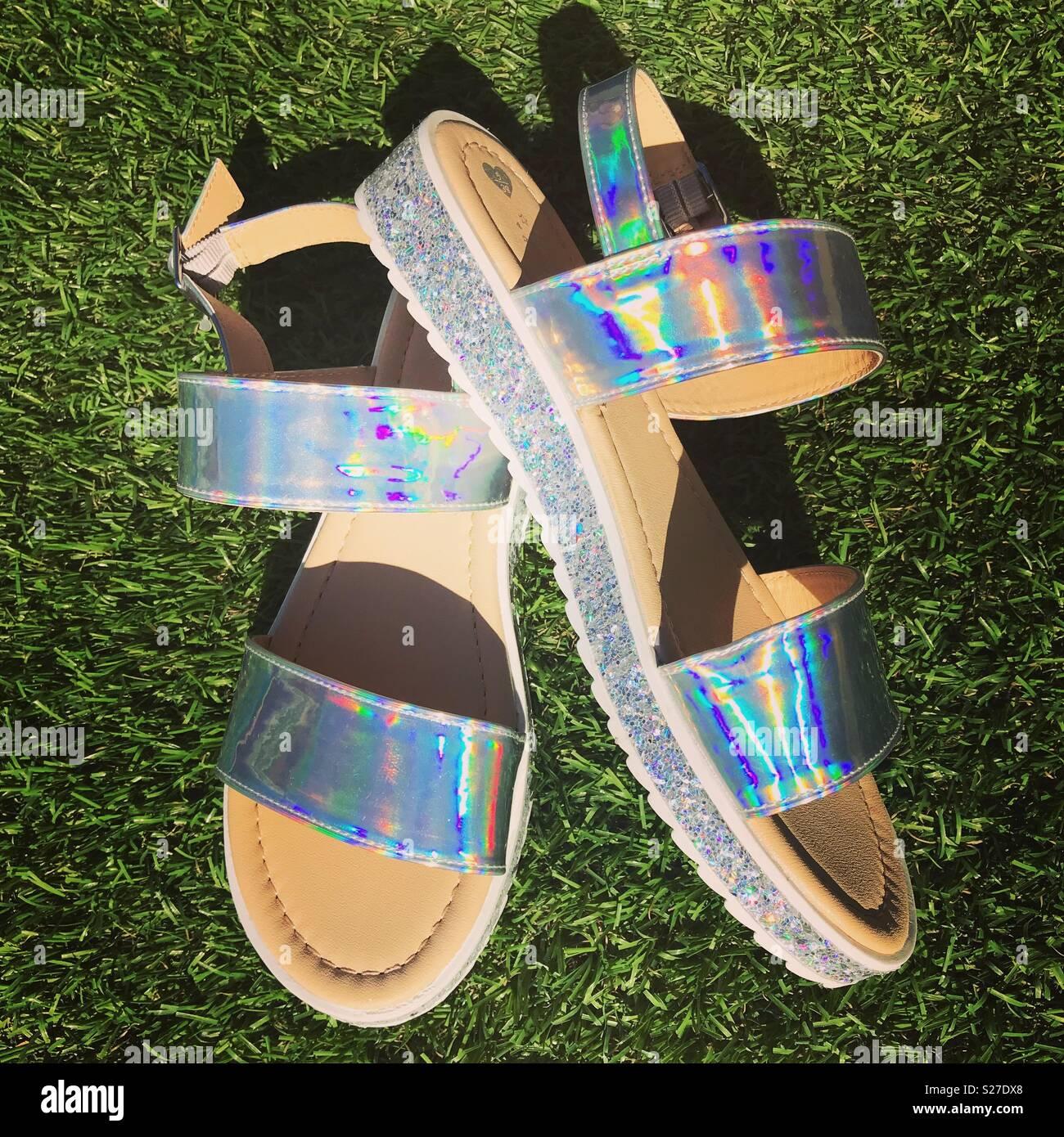 Holographic ladies sandals - Stock Image