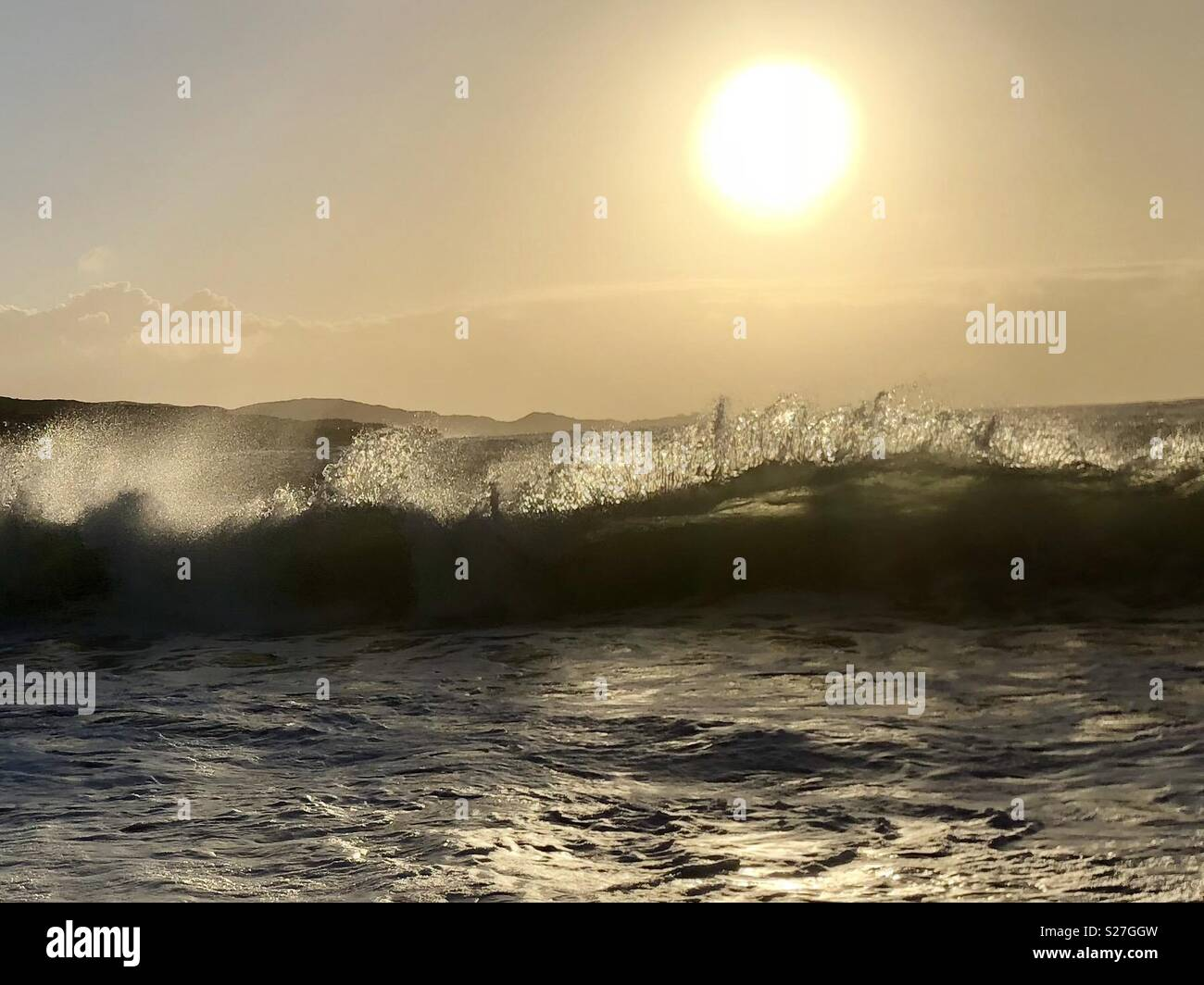 Wave at Sunset - Stock Image