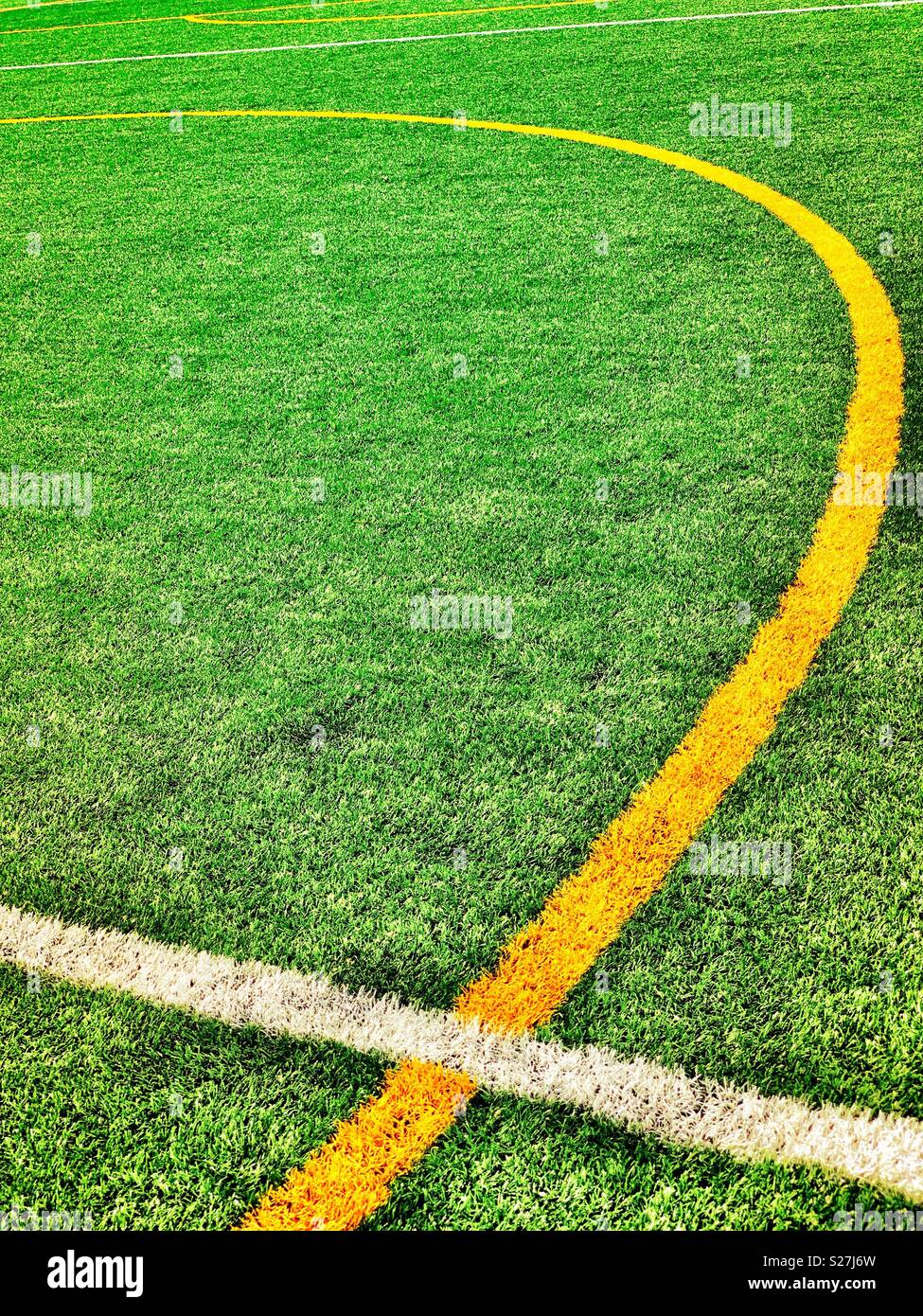 Soccer white and yellow field pitch demarcation lines, artificial turf, center circle, halfway line - Stock Image
