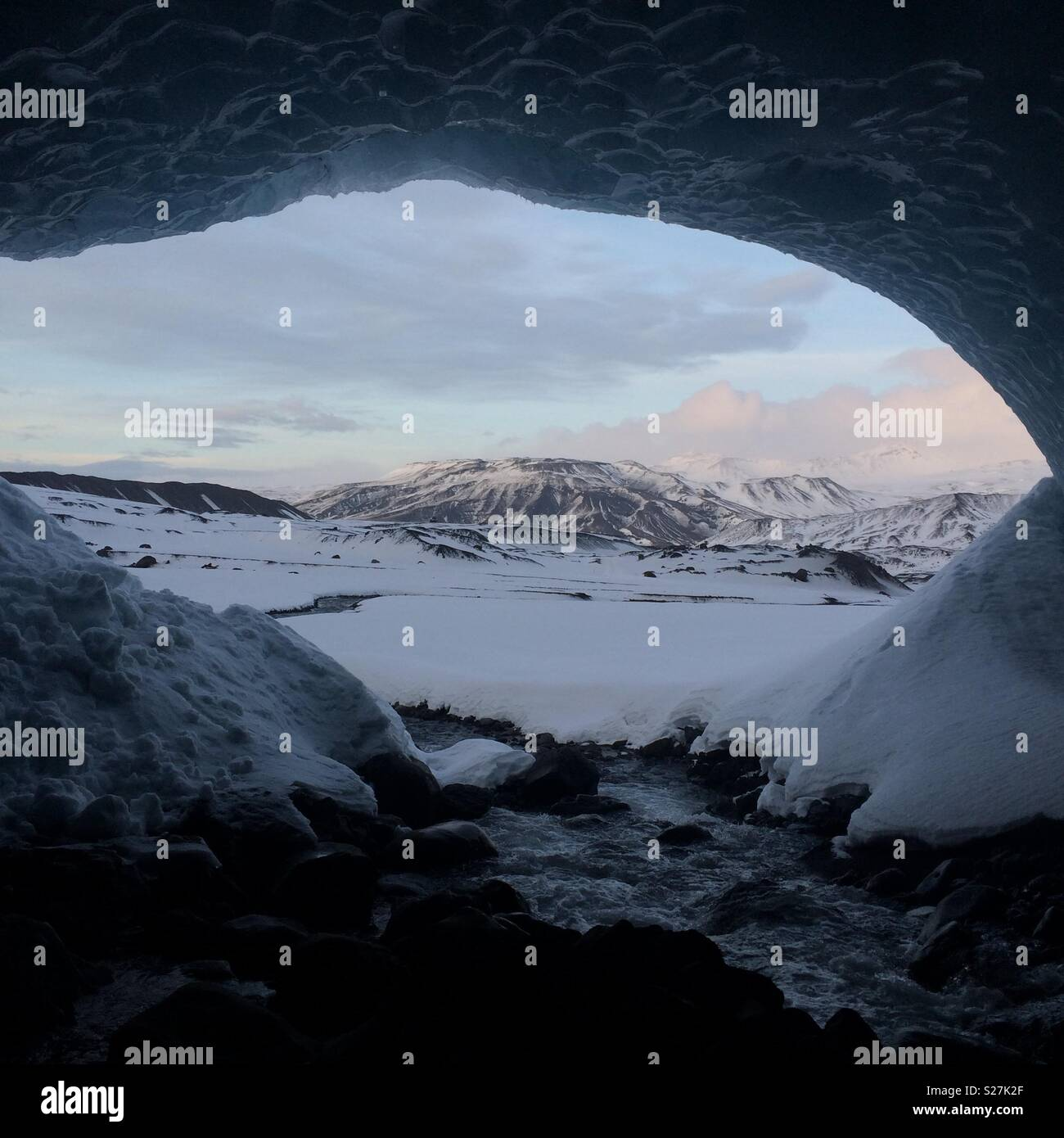 View from inside an ice cave in Iceland - Stock Image