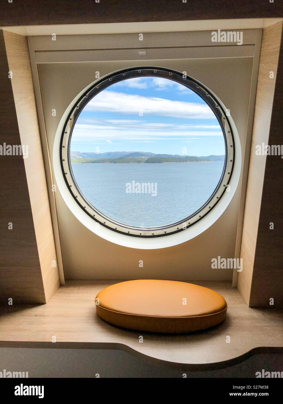 View through a porthole off the coast of Norway. - Stock Image