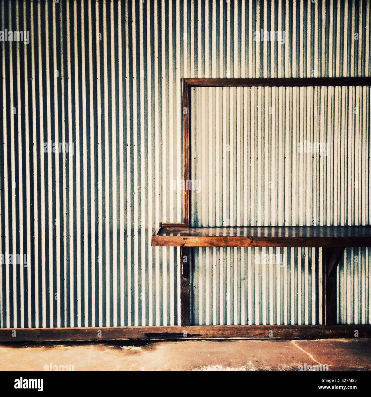 The corrugated steel wall of a closed snack bar in Mississippi - Stock Image