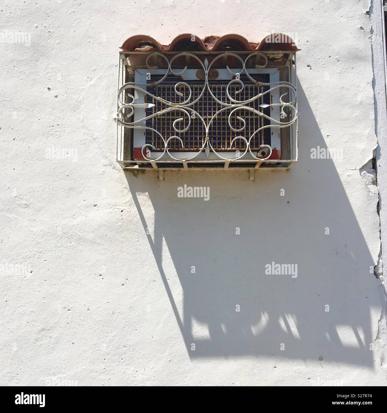 Old decorative grill on air conditioner in  Cuba - Stock Image