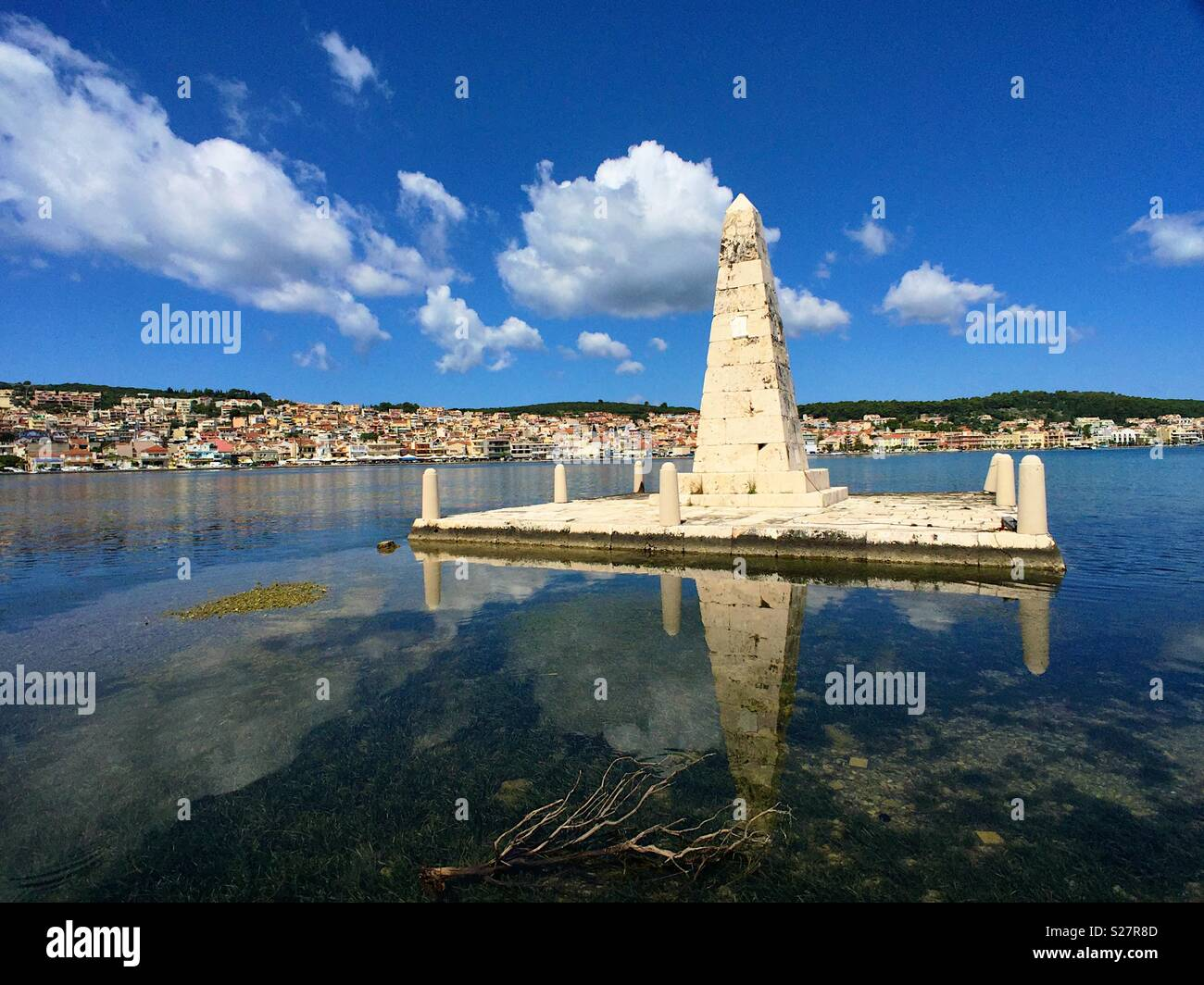 View of Argostoli Kefalonia from the Drepano bridge showing a stone column built by the British to celebrate their presence - Stock Image