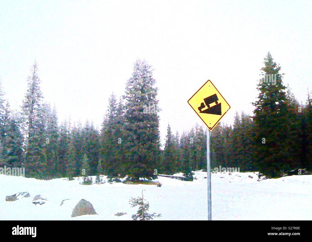 Downhill traffic sign. - Stock Image