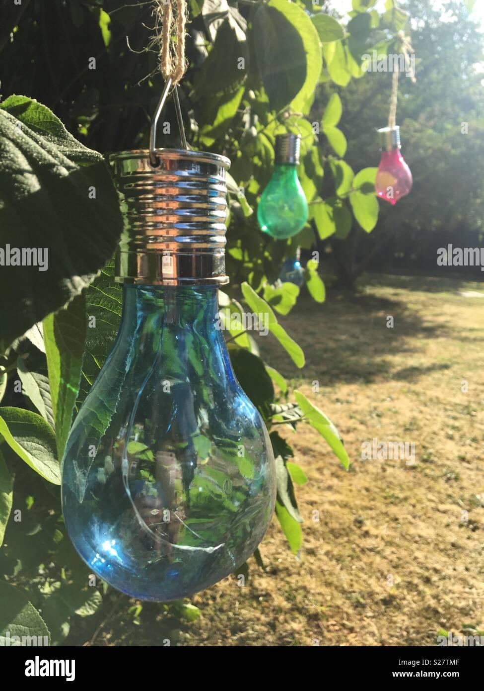Brightly coloured solar garden lights - Stock Image