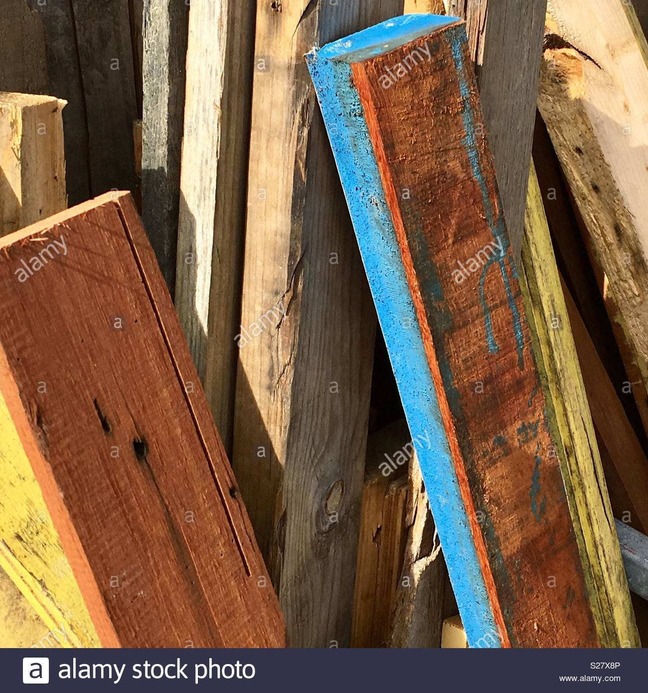 Colourful planks of wood - Stock Image