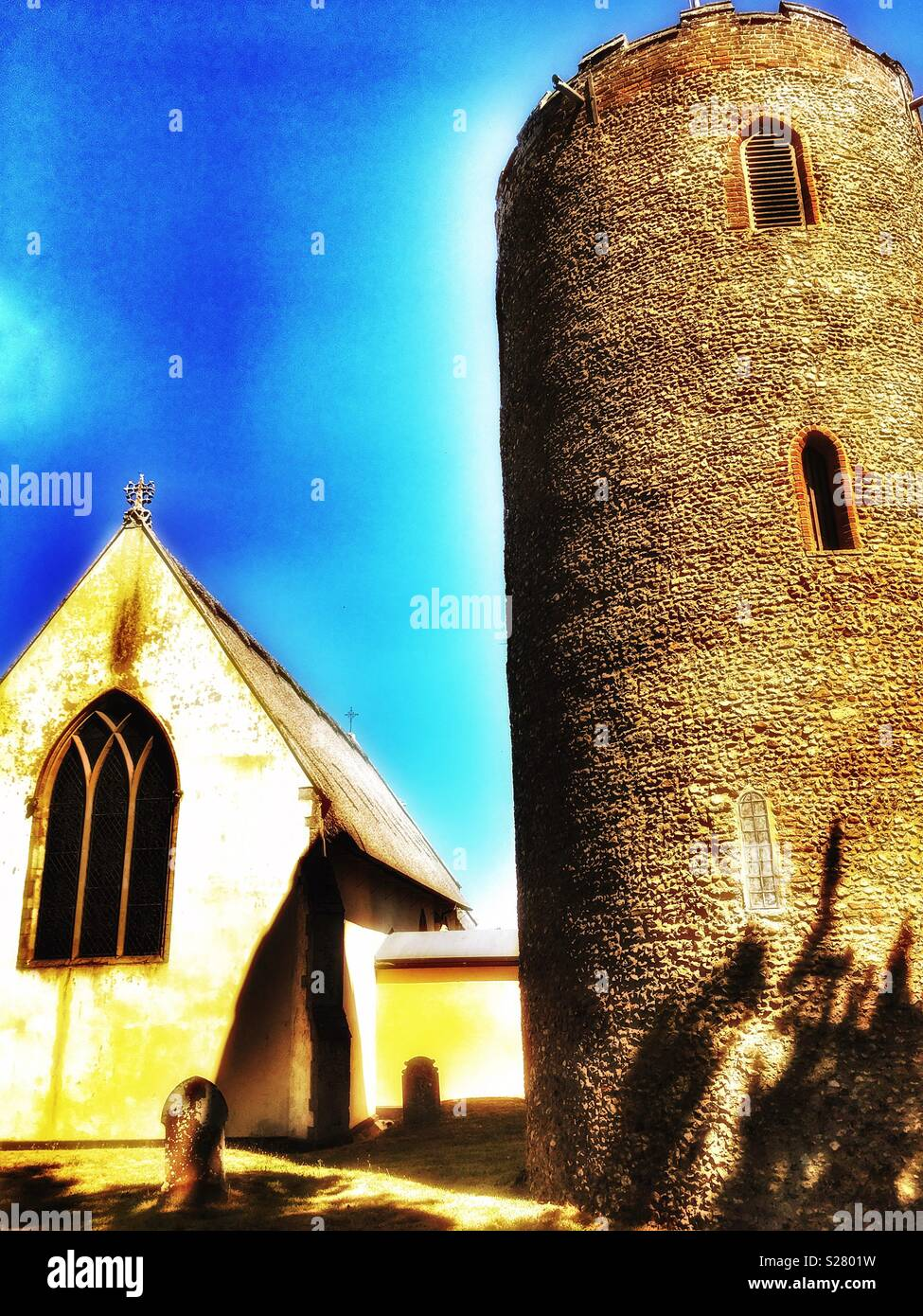 Church and separated tower, Bradfield, Suffolk, England. - Stock Image