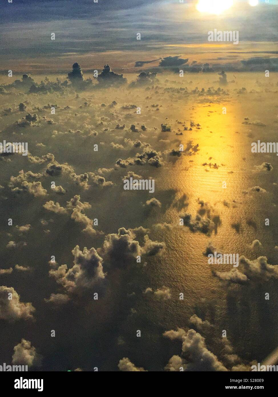 Clouds over the South China Sea in the golden light of late afternoon - Stock Image