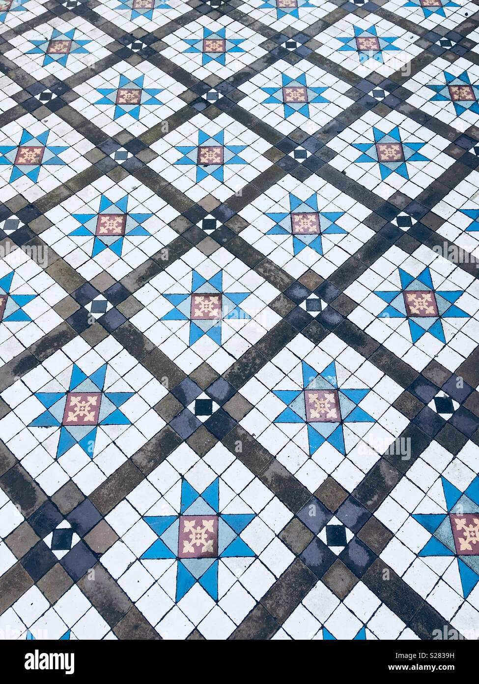 Victorian floor tiles -cool - Stock Image