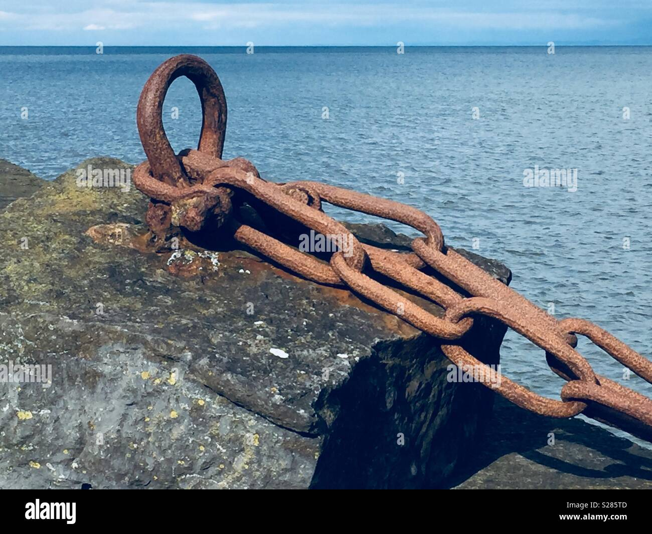 Boats Long Gone leaving chains to Rust - Stock Image