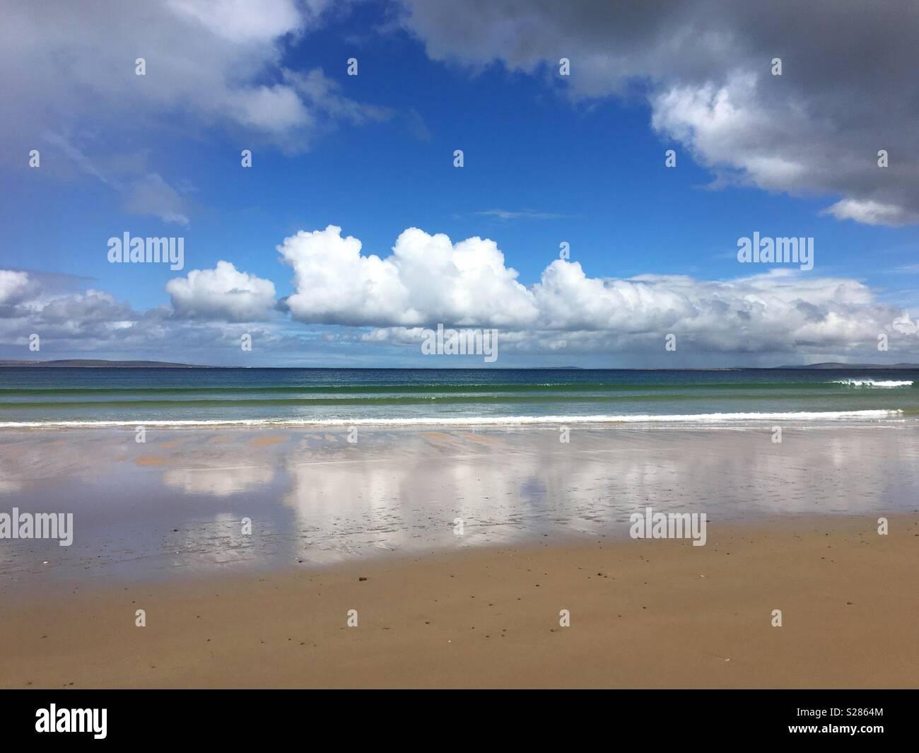 Beach, sea, blue sky and clouds on Achill Island, County Mayo, Ireland - Stock Image