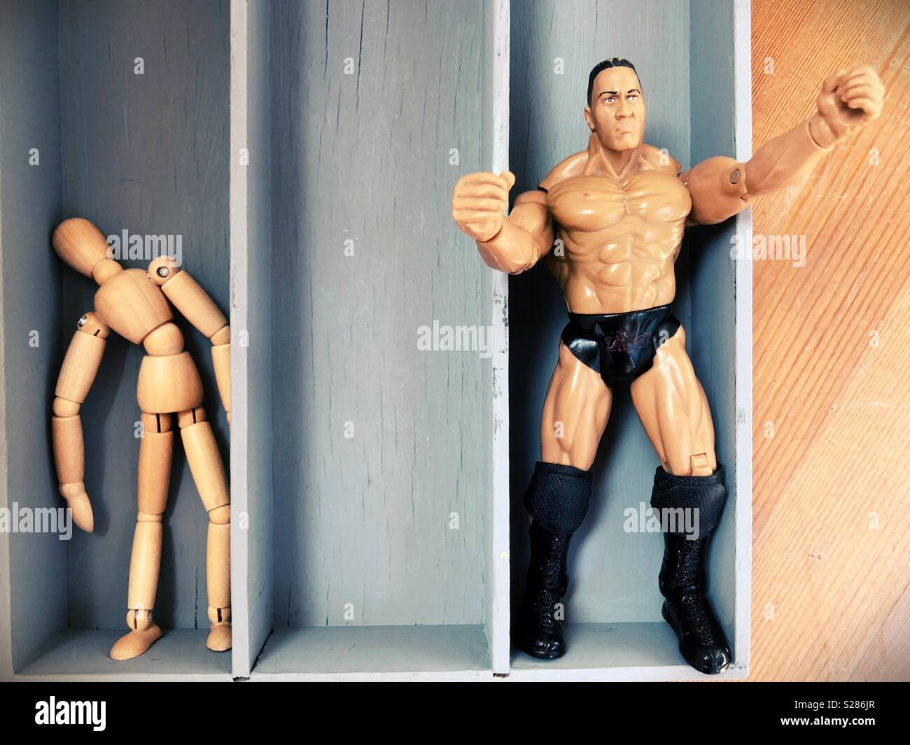Conceptual weak vs. strong. Stock Photo