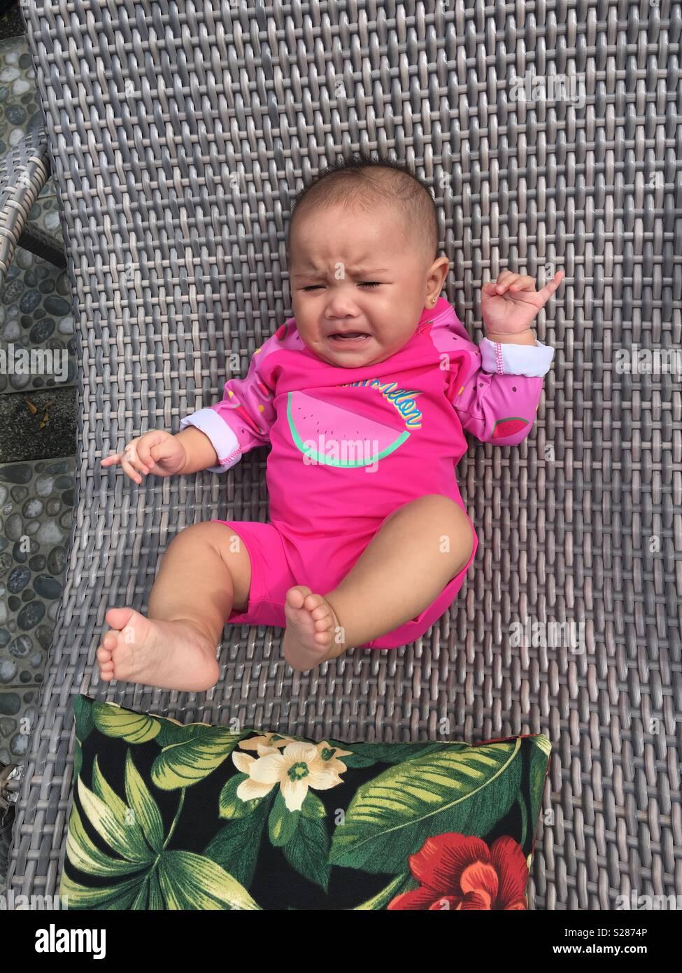 7db26fd947f7 Cute baby in her swim attire Stock Photo  311197174 - Alamy
