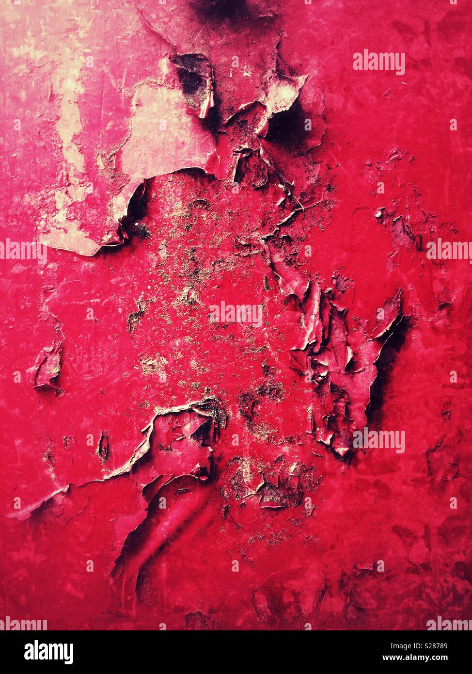 Blistered and peeling red paint on the rusty metal work - Stock Image