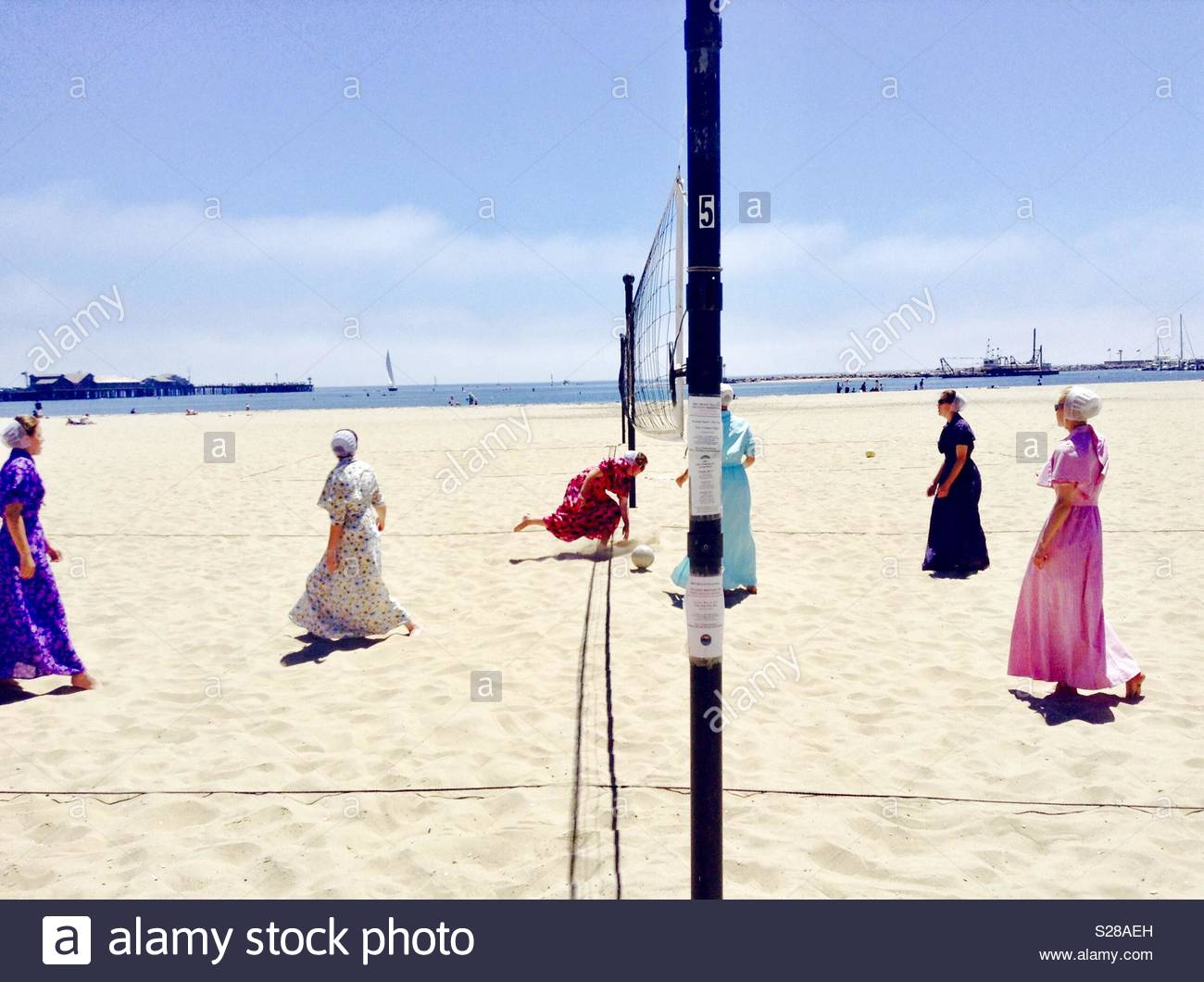 Women appearing as Mennonites, wearing bonnets and long dresses play