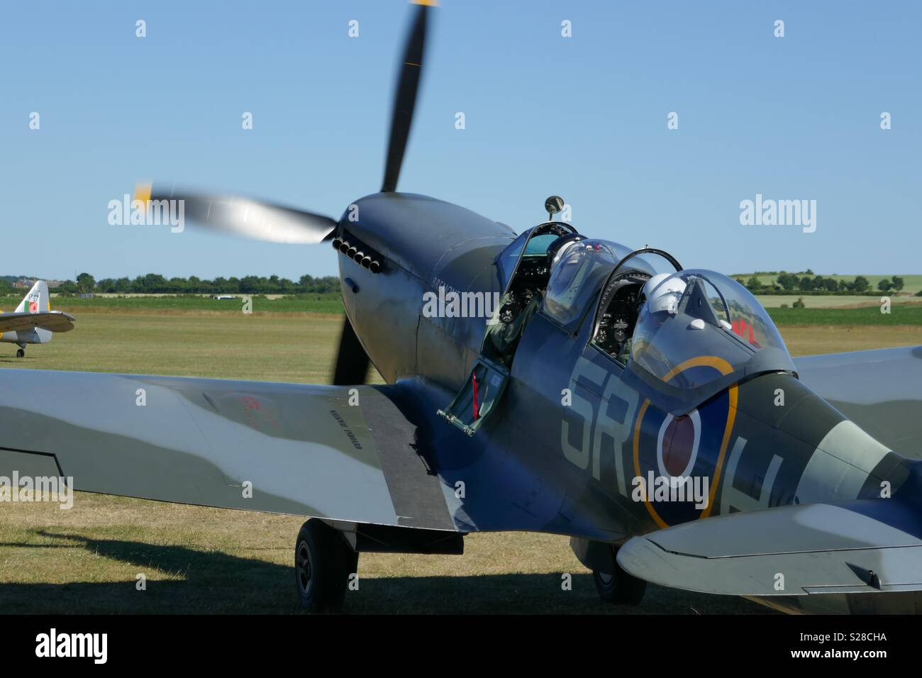 Spitfire taxiing to take off at Duxford Aerodrome, UK - Stock Image