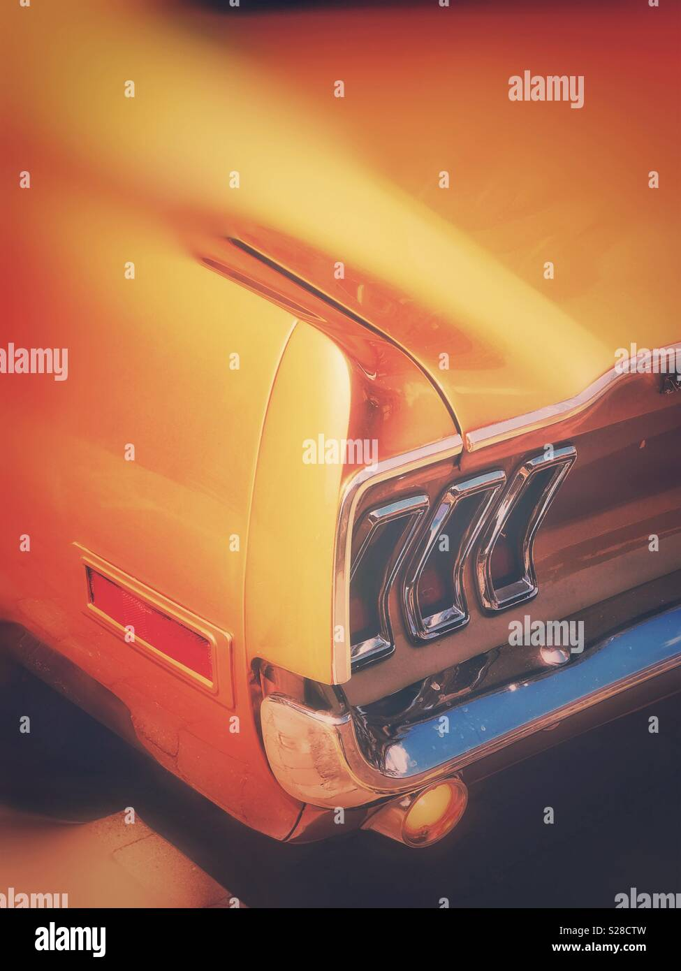 The rear of a Ford Mustang car - Stock Image