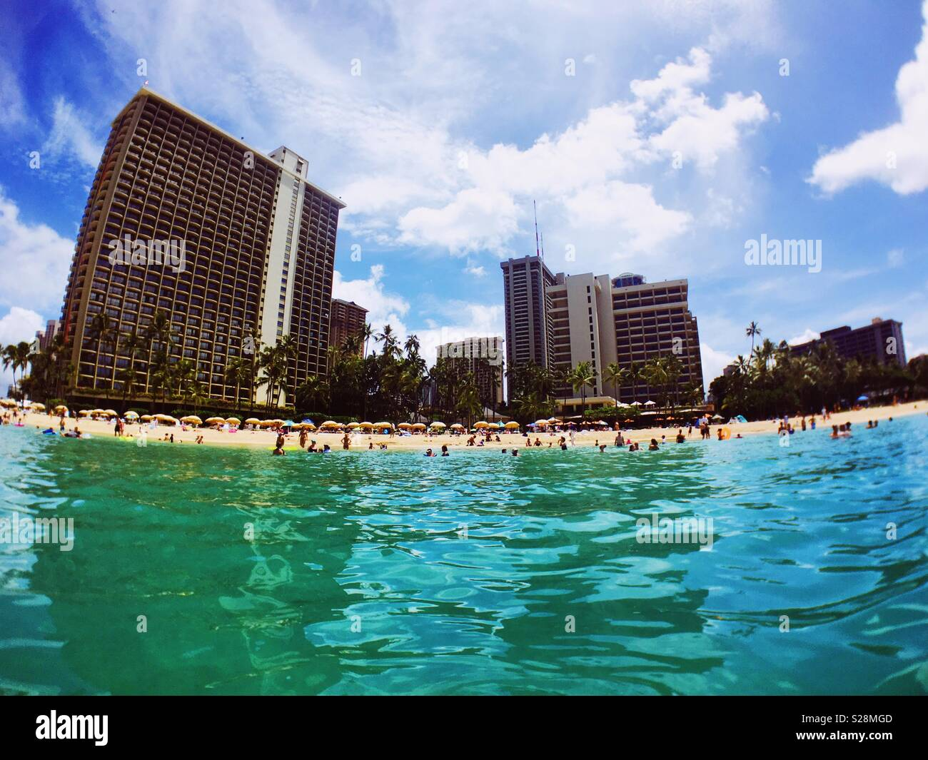 Hilton Hawaiian Village and beach as seen from the ocean. July 2018. - Stock Image