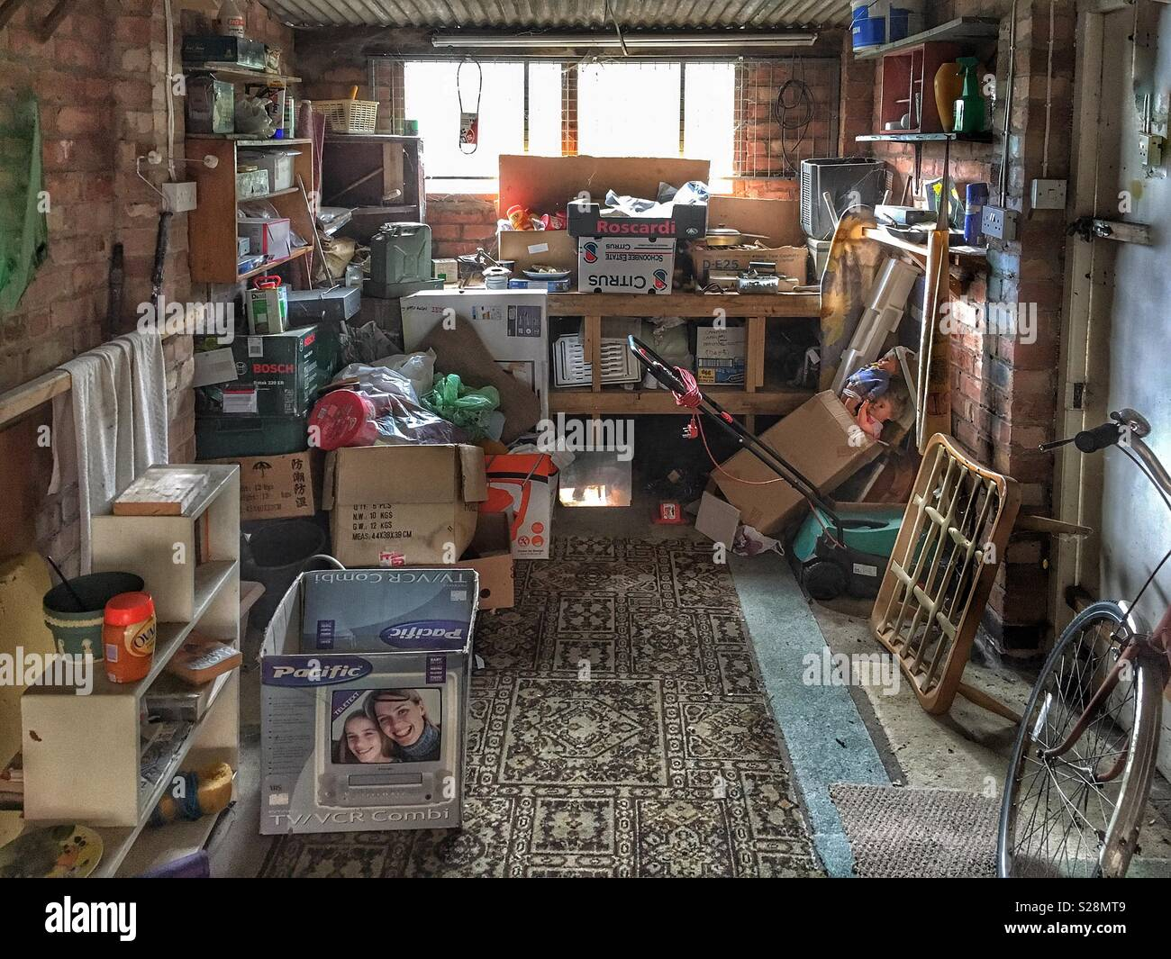 A garage full of junk - Stock Image