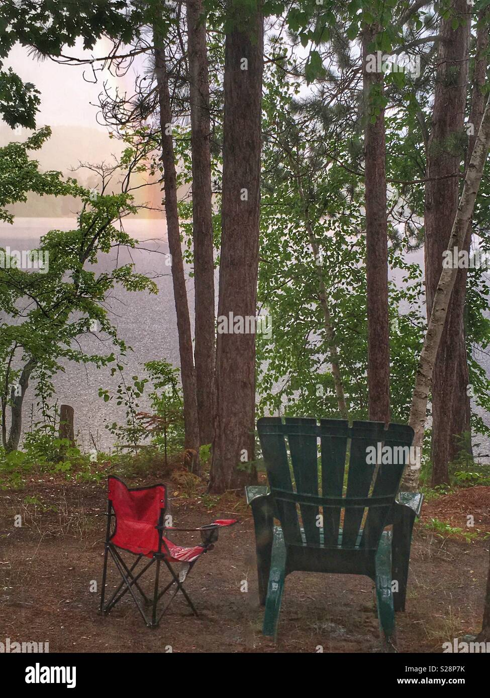 Rainbow in cottage country, summer storm - Stock Image