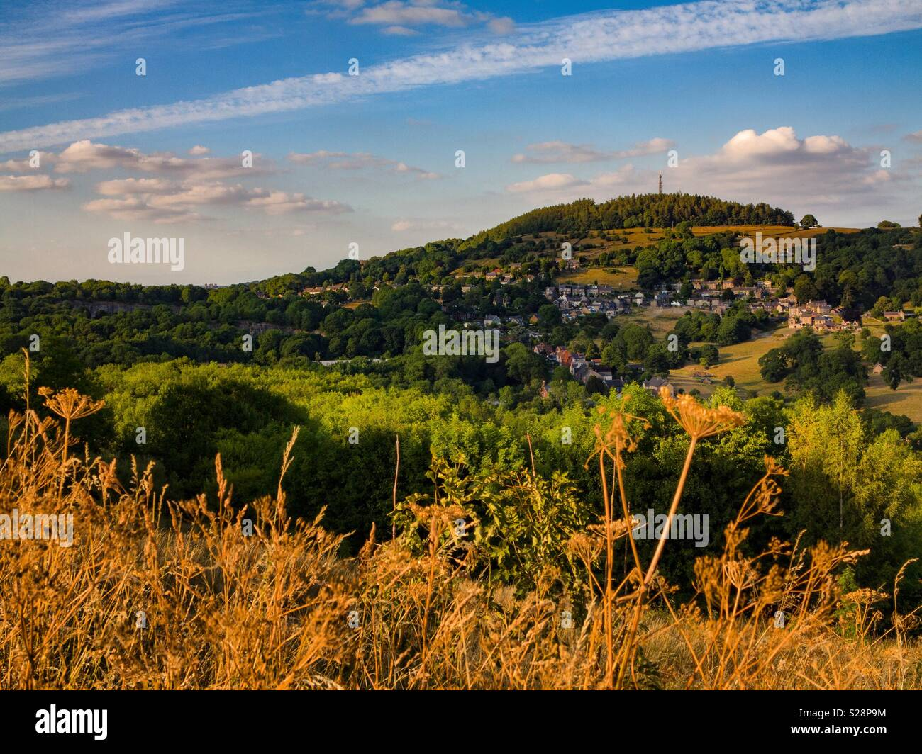 View over the hills near Wirksworth in the Derbyshire Peak District towards Black Rocks England UK - Stock Image