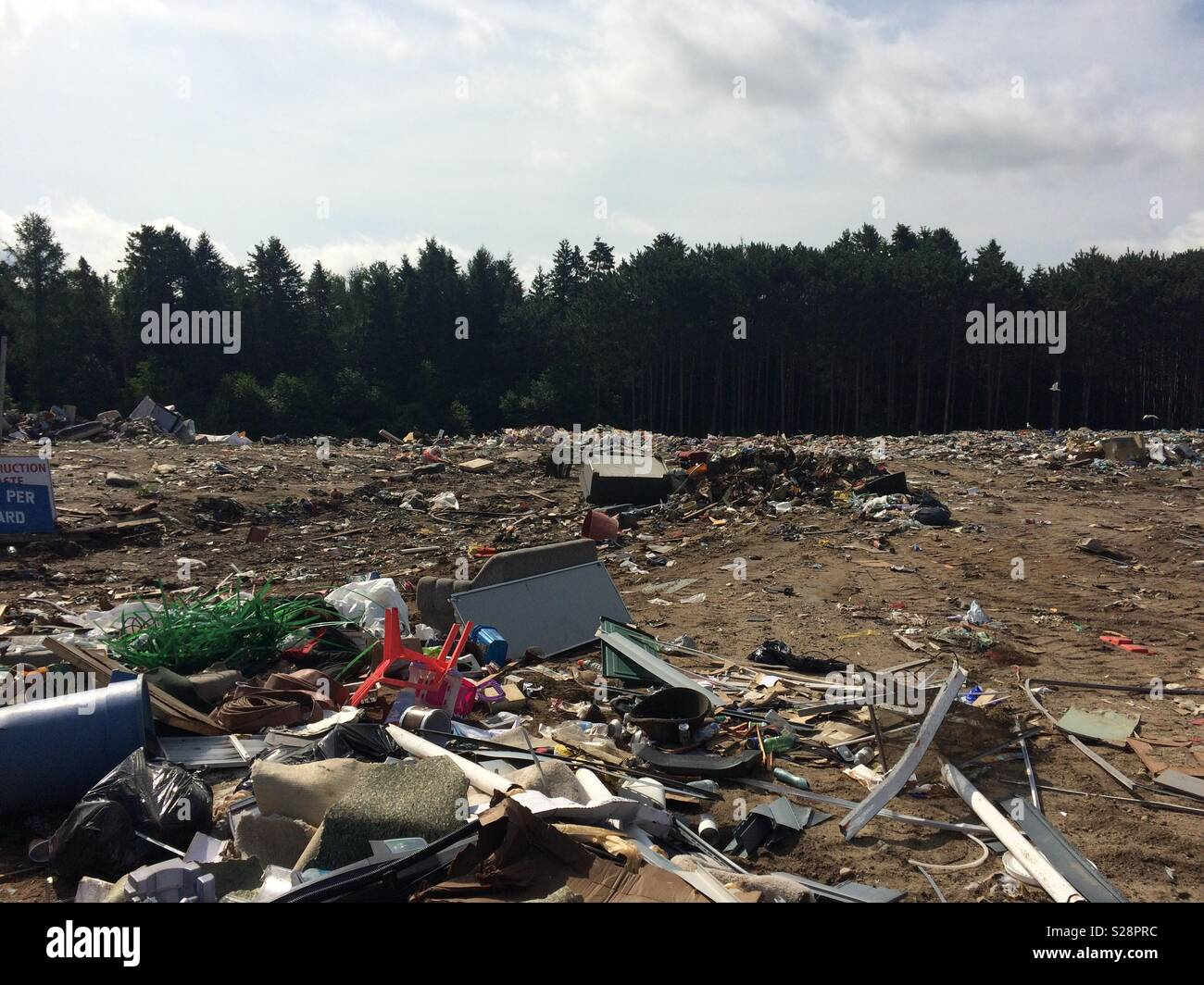 Landfill on a cloudy day - Stock Image