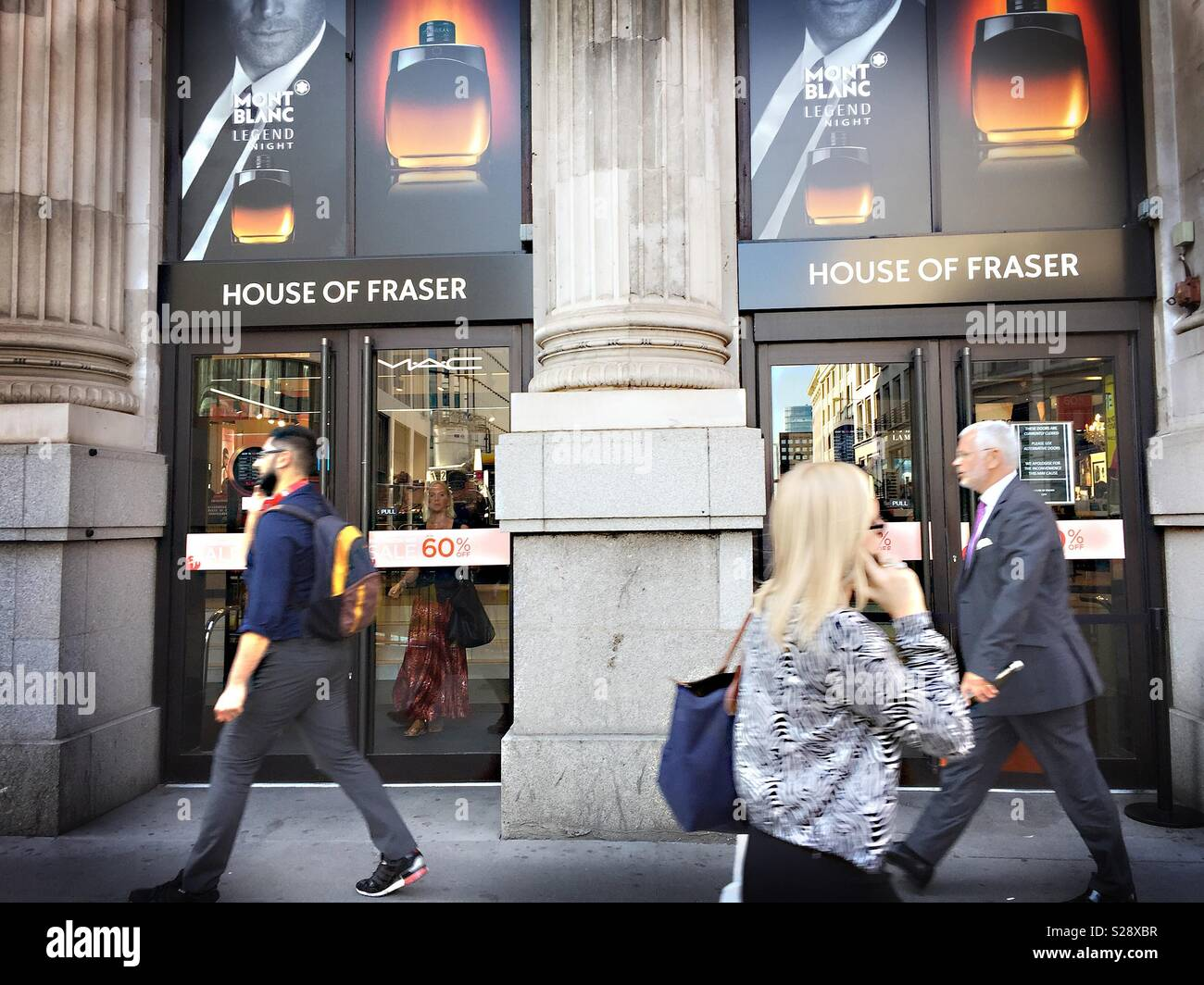 People walk past House of Fraser department store, with sale sign in window. Moorgate, London. UK - Stock Image