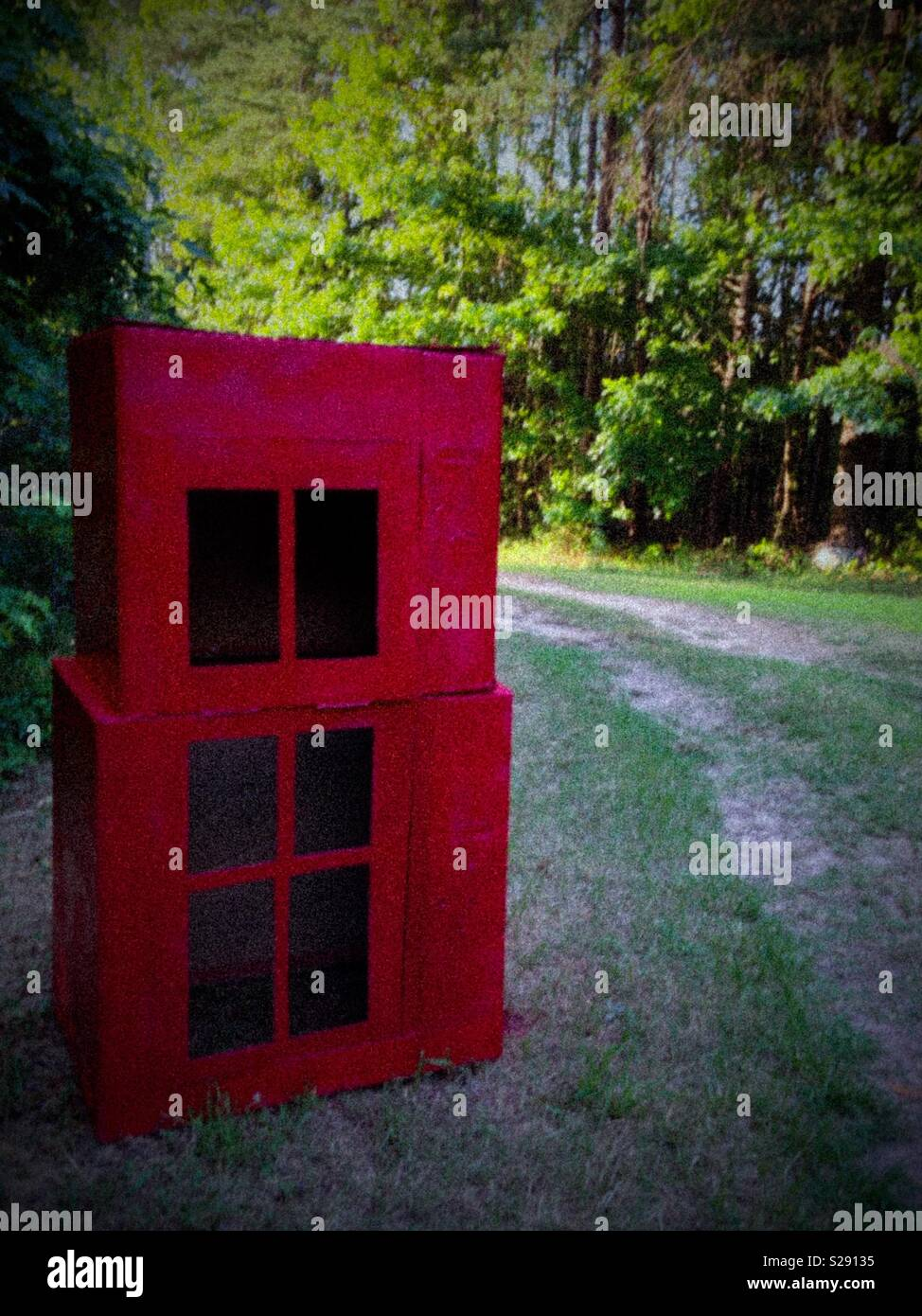 Grainy photo of red telephone kiosk made of TV boxes for Vacation Bible School - Stock Image