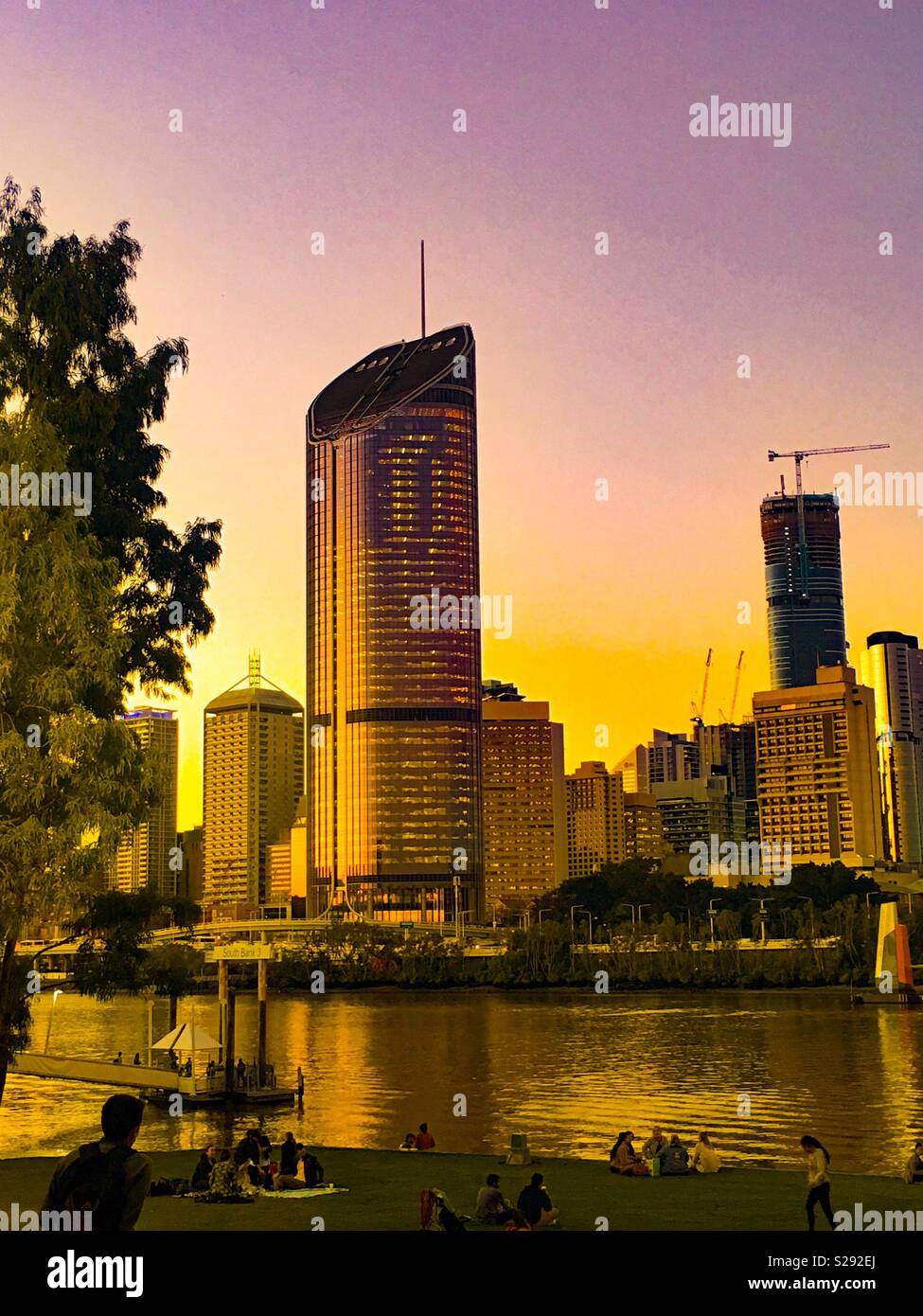 Brisbane City skyline at dusk with river frontage - Stock Image