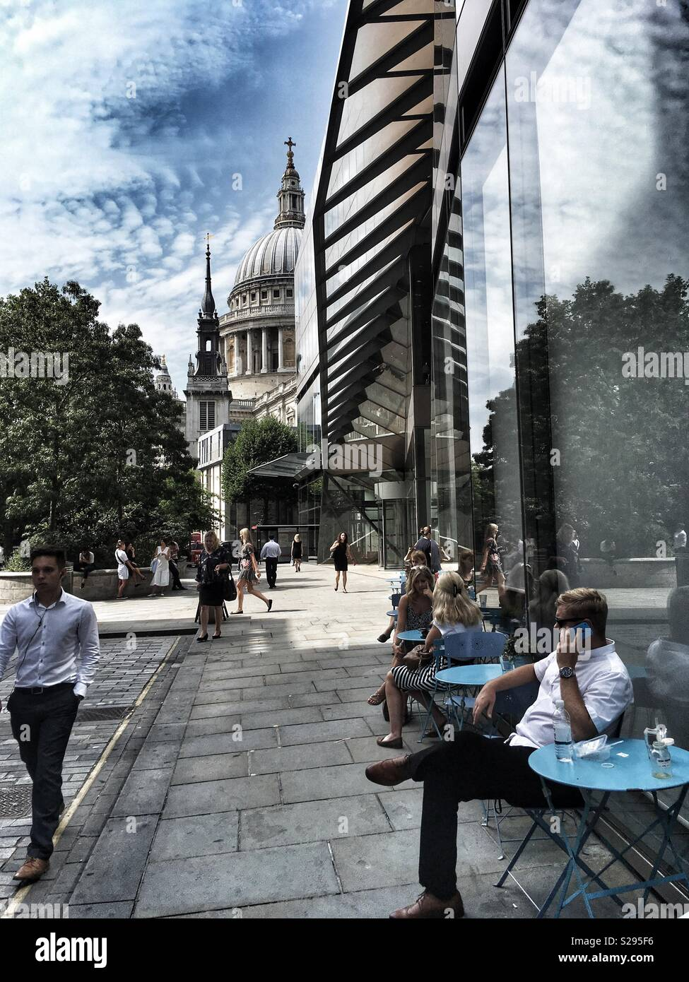 People sat outside One New Change in London, England - Stock Image