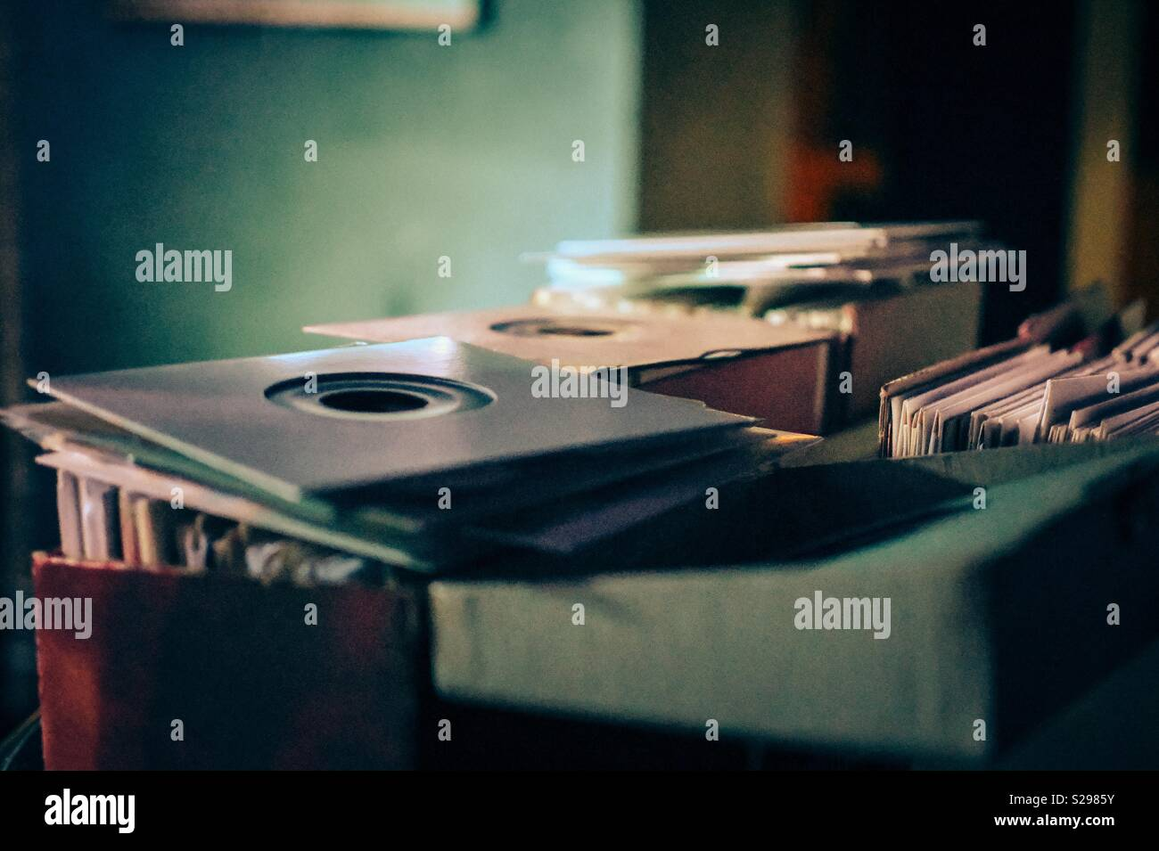 45 rpm records stacked up at a soul DJ night I. Vancouver, Canada - Stock Image