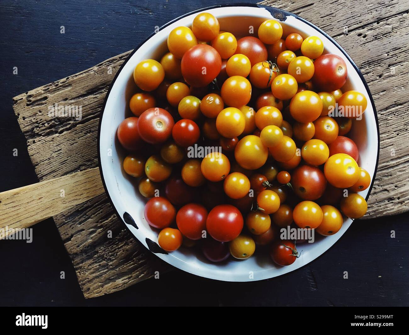 Cherry tomatoes harvested from an urban garden - Stock Image