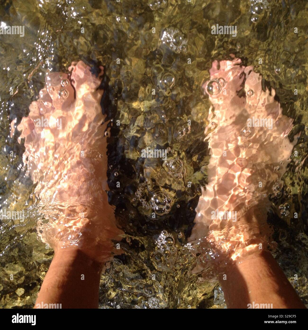 Heat wave, cooling feet in the water - Stock Image