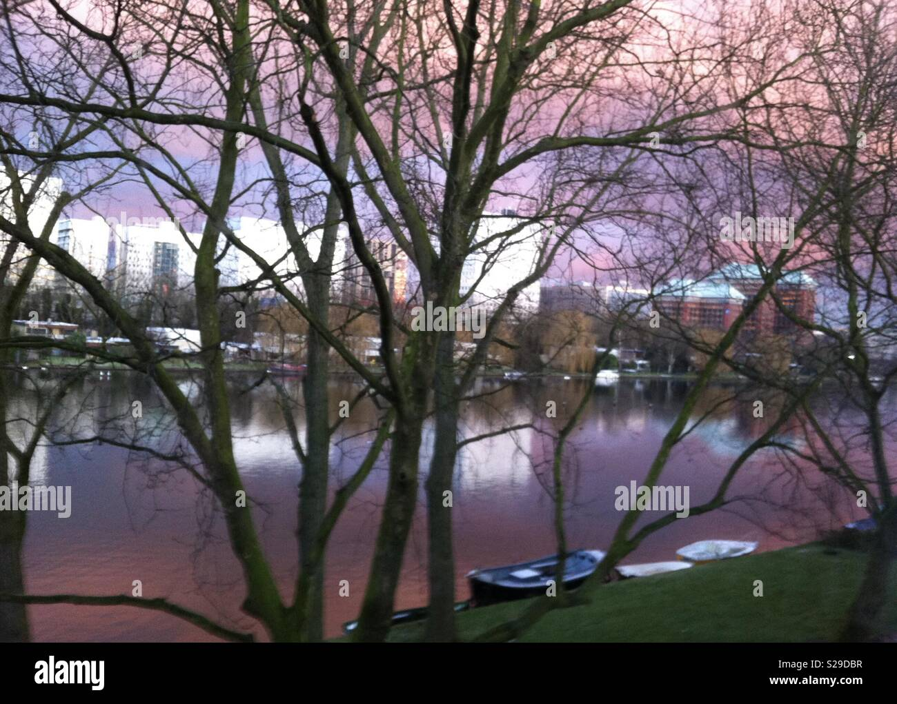 Pinky sunset in Amsterdam canal - Stock Image