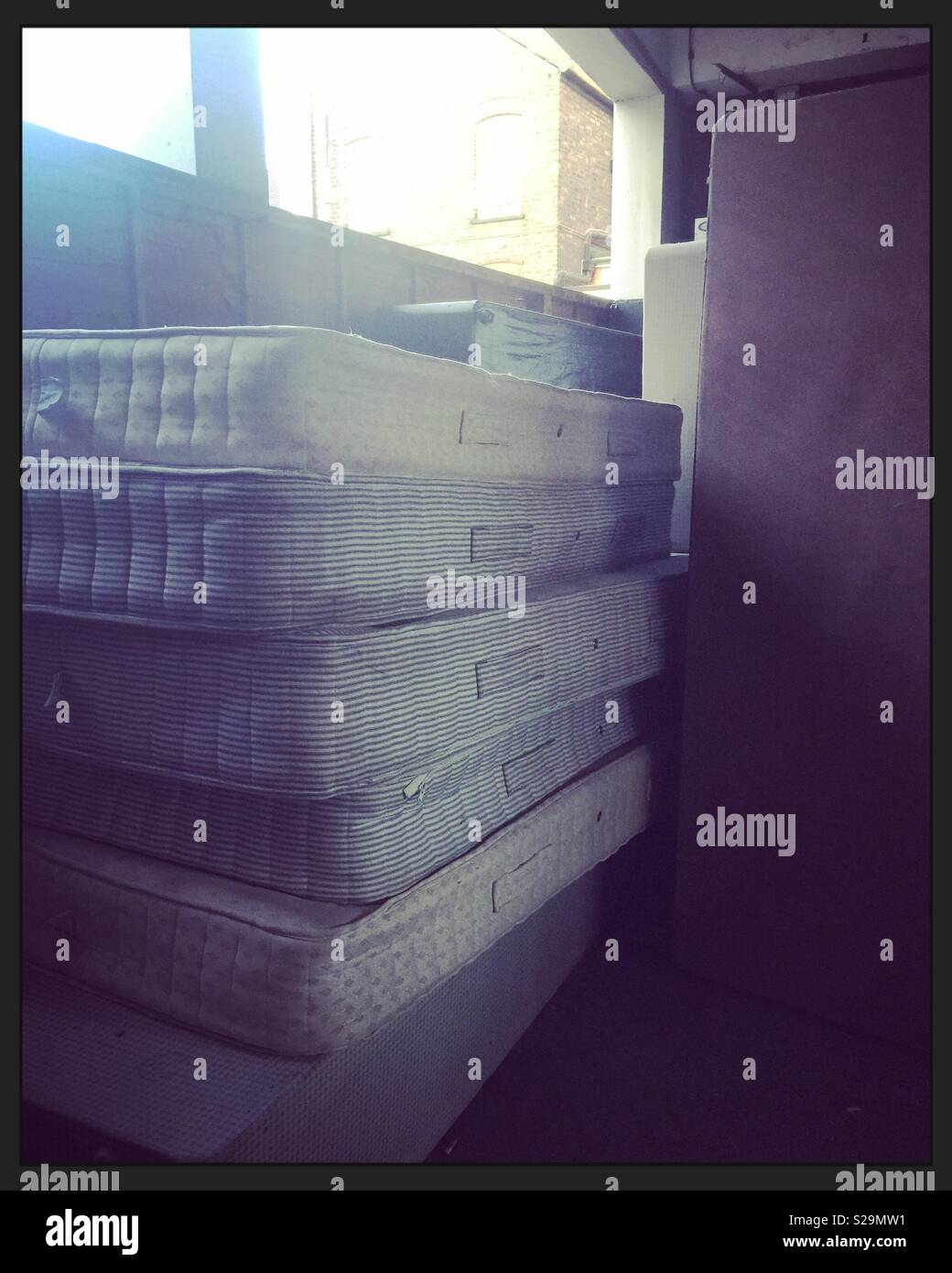 Stacked mattresses at a hotel - Stock Image
