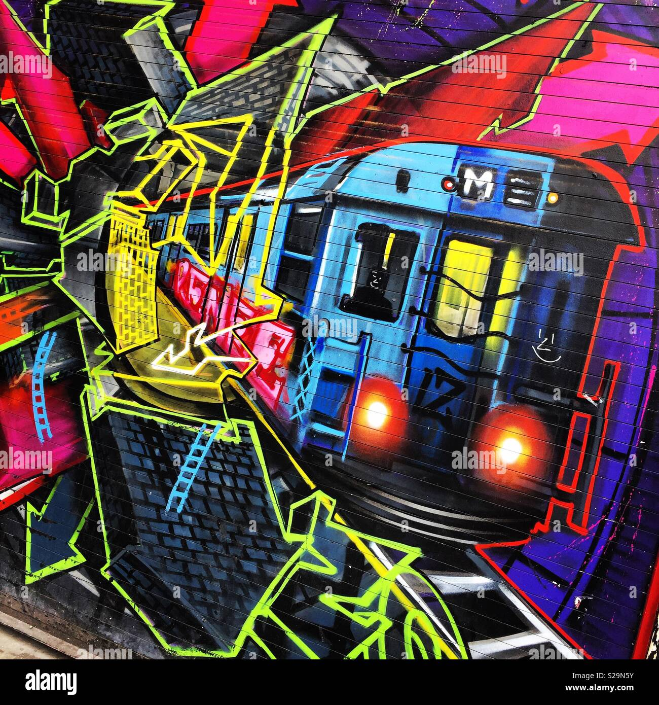 Metro train street art - Stock Image