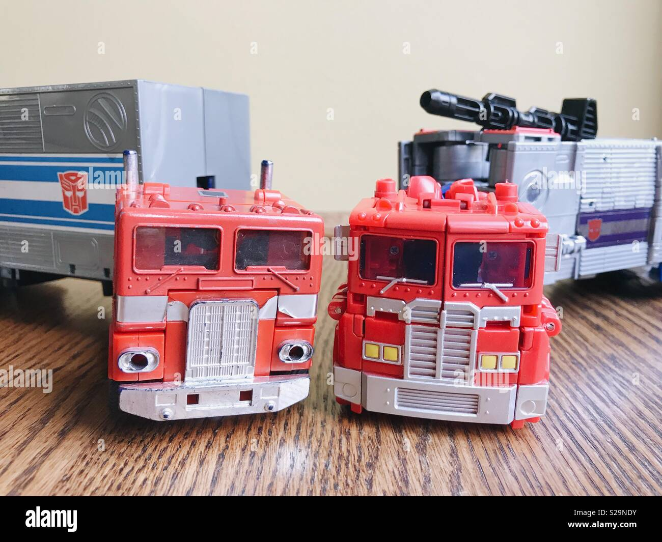 Comparison between Transformers toys old and new: original vintage Optimus Prime (left) and new Optimus Prime from 2018 (right). Stock Photo