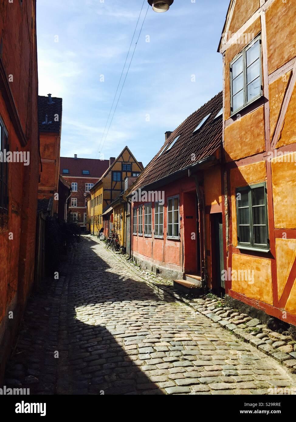 An old colorful street in Helsingoer, Denmark - Stock Image